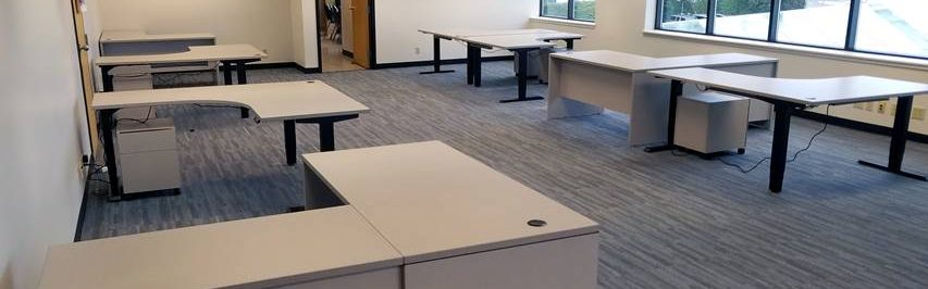 Mix of Series and Systems Casegoods.  Shells and Returns, Height Adjustable Corner Surfaces, Mobile Pedestals.