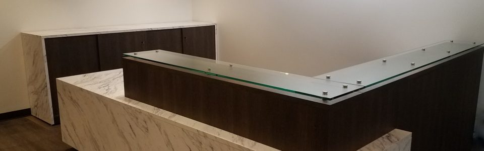 L-Shaped Reception Station with Glass Transaction Counter